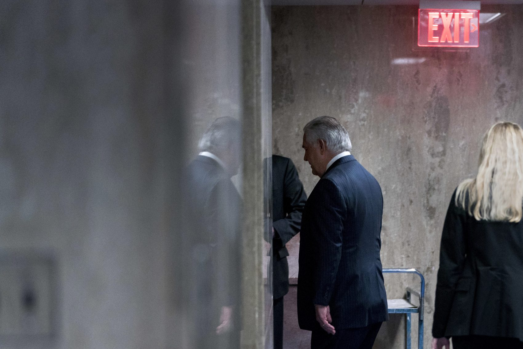 Secretary of State Rex Tillerson walks down a hallway after speaking at a news conference at the State Department in Washington, Tuesday, March 13, 2018. (Andrew Harnik/AP)