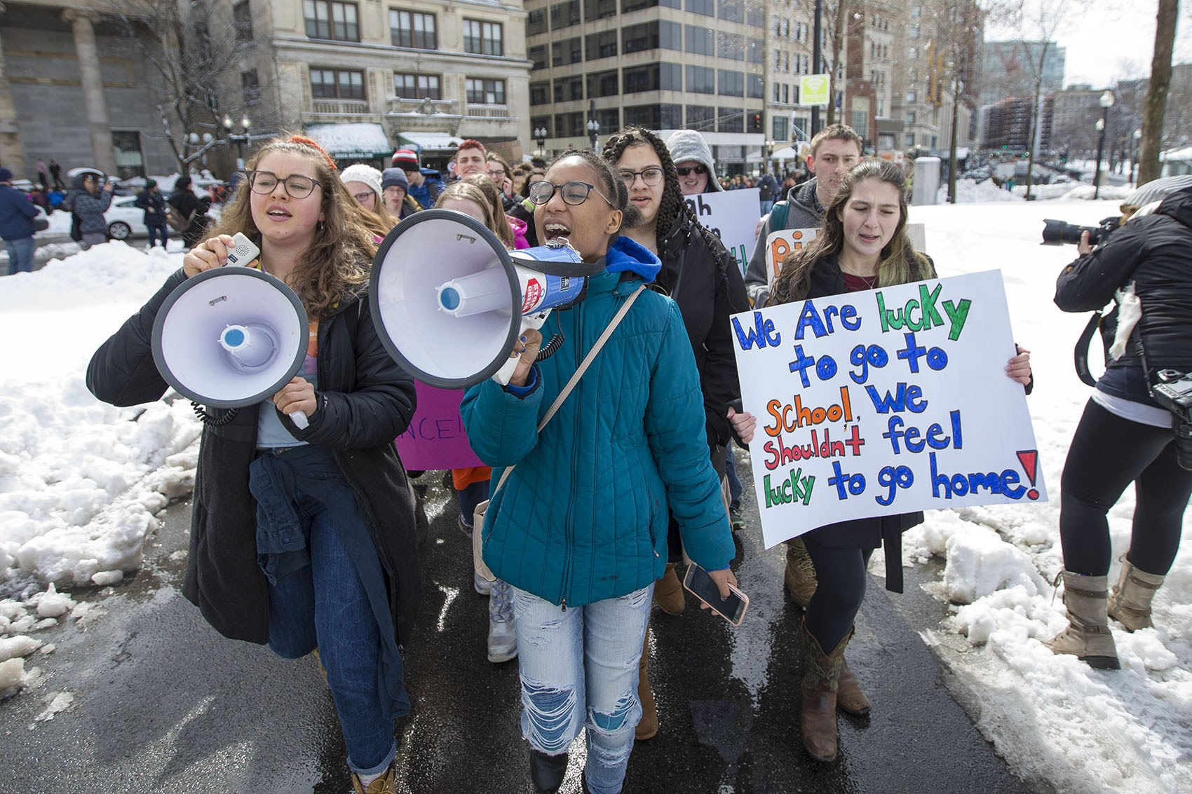 Students march across Boston Common from St. Paul's Cathedral to the Massachusetts State House. (Jesse Costa/WBUR)