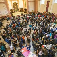 Boston-area students gather at St. Paul's Cathedral on Tremont Street in Boston prior to marching to the State House to meet with legislators. (Jesse Costa/WBUR)