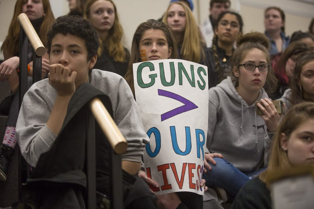 Students watch and listen to other student speeches demanding action against gun violence. (Jesse Costa/WBUR)