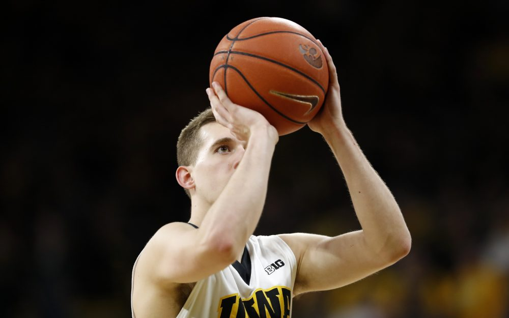 Iowa guard Jordan Bohannon had hit 34 free throws in a row when he stepped to the line with a chance to break the school record. (Charlie Neibergall/AP)