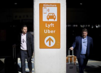 A sign directs Lyft and Uber riders to a designated pickup location at Hartsfield-Jackson Atlanta International Airport in Atlanta, Wednesday, Jan. 31, 2018. (David Goldman/AP)
