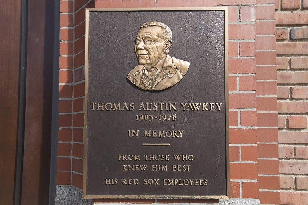 On the Fenway Park wall on Yawkey Way, a plaque is mounted honoring Thomas Yawkey. (Jesse Costa/WBUR)