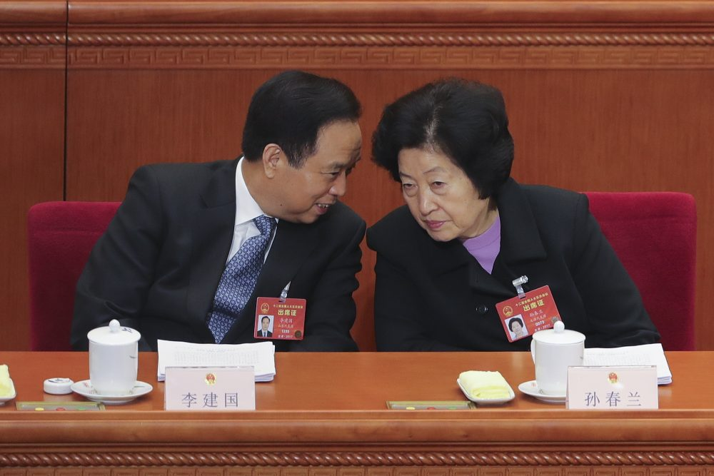 Vice chairman of the Standing Committee of the National People's Congress Li Jianguo (left) talks with Sun Chunlan, head of the United Front Work Department of the Communist Party of China Central Committee, at the Third Plenary Session of the Fifth Session of the 12th National People's Congress (NPC) at the Great Hall of the People on March 12, 2017 in Beijing. (Lintao Zhang/Getty Images)