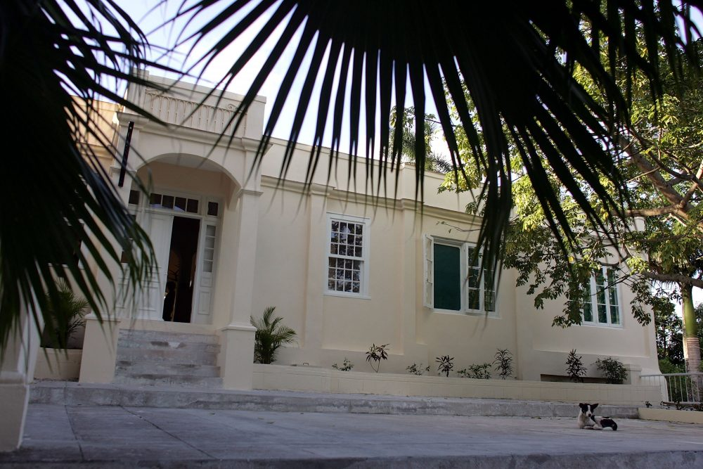 "A dog lays in front of Finca Vigía, or ""Lookout Farm,"" author Ernest Hemingway's home from 1939 to 1960, in Havana, Cuba. Built in 1886 on a hillside, the home is where Hemingway wrote ""For Whom the Bell Tolls,"" ""The Old Man and the Sea,"" ""A Moveable Feast"" and ""Islands in the Stream."" With the help of American preservationists, the home is on its way to being restored. (Joe Raedle/Getty Images)"