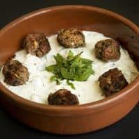 Lamb-feta-mint meatballs with yogurt sauce and toasted walnuts, from chef Kathy Gunst. (Robin Lubbock/WBUR)