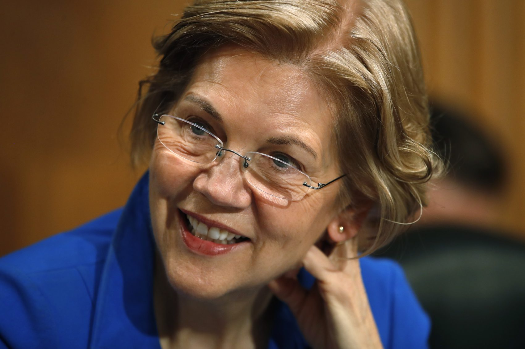 Sen. Elizabeth Warren, D-Mass., arrives for a Senate Banking Committee hearing on the nomination of Marvin Goodfriend to be a member of the Federal Reserve Board of Governors on Jan. 23 on Capitol Hill in Washington. (Jacquelyn Martin/AP)