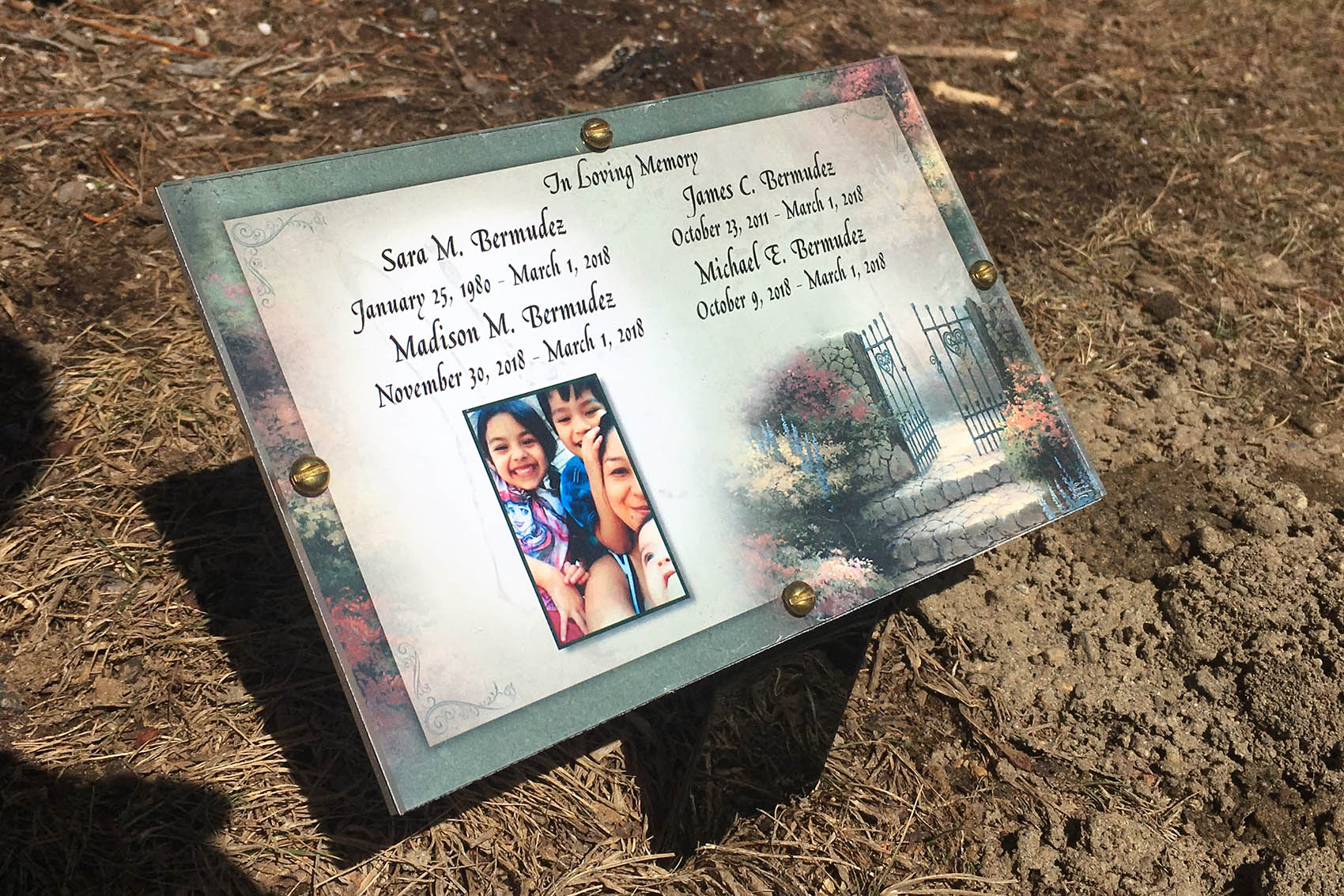 A plaque at the family gravesite in West Brookfield, Mass. Sara Bermudez and her children were interred together. (Shannon Dooling/WBUR)
