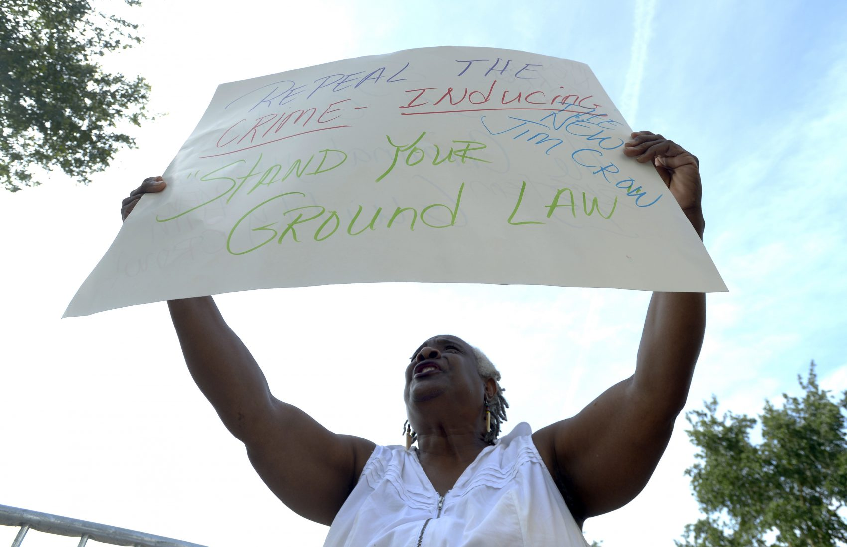 Barbara Jackson, of Sanford, Fla., protests outside the Seminole County Courthouse during the George Zimmerman trial Tuesday, June 11, 2013, in Sanford. (Phelan M. Ebenhack/AP)