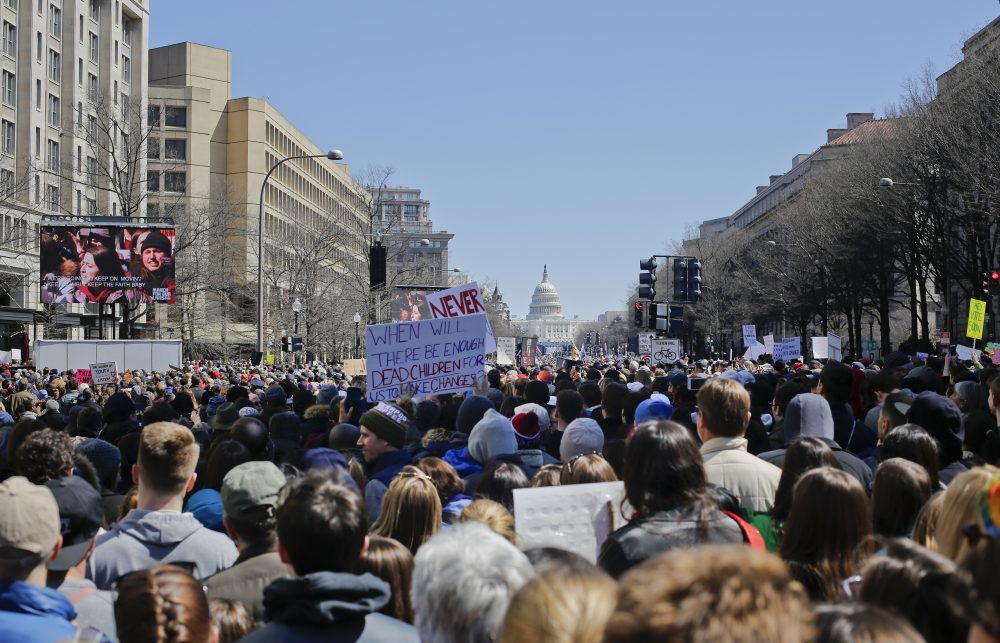 "People gather on Pennsylvania Ave., during the ""March for Our Lives"" rally in support of gun control, Saturday, March 24, 2018. (AP Photo/Pablo Martinez Monsivais)"