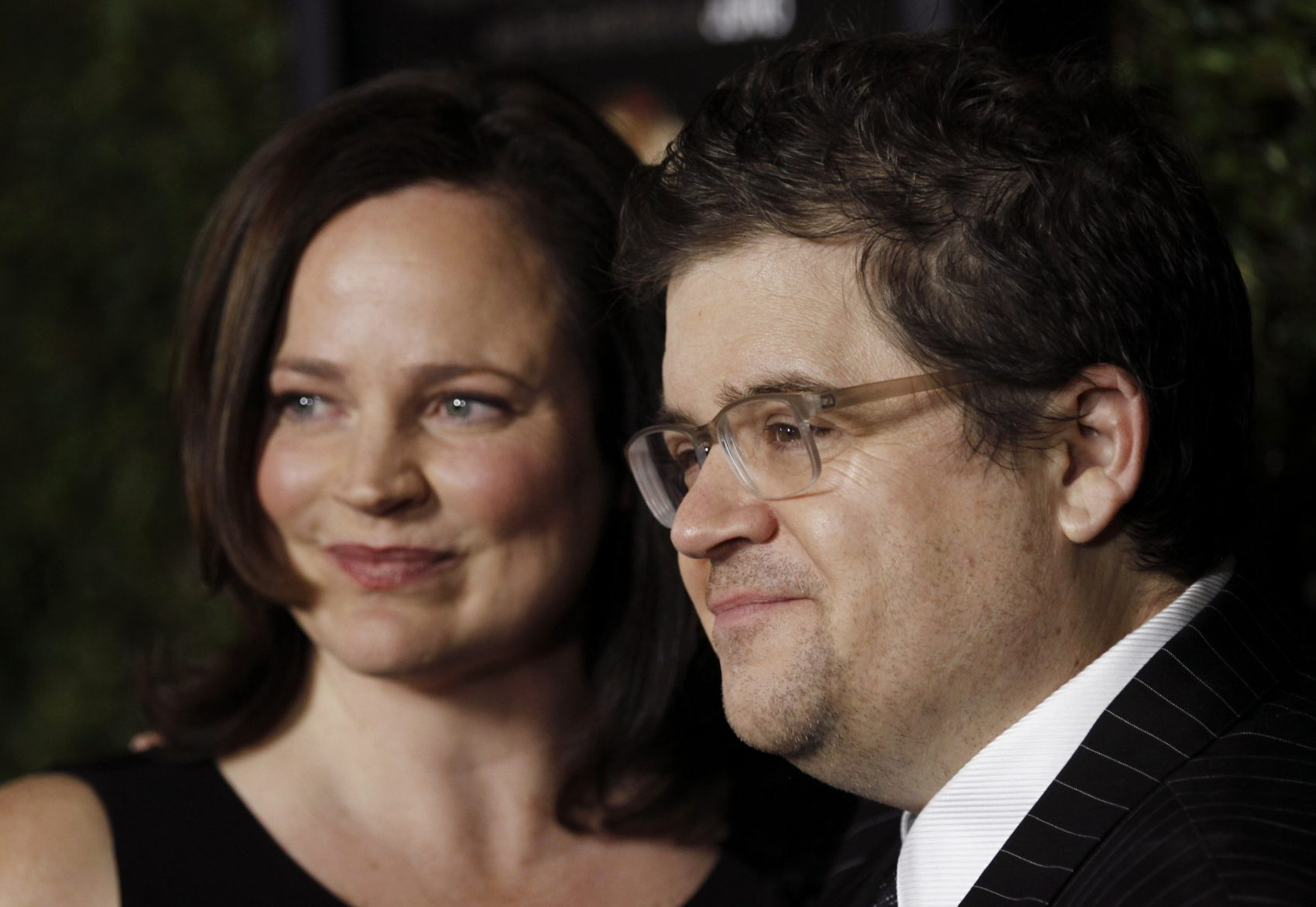 """Patton Oswalt, right, and Michelle Eileen McNamara arrive at the premiere of """"Young Adult"""" in Beverly Hills, Calif., Thursday, Dec. 15, 2011. (Matt Sayles/AP)"""