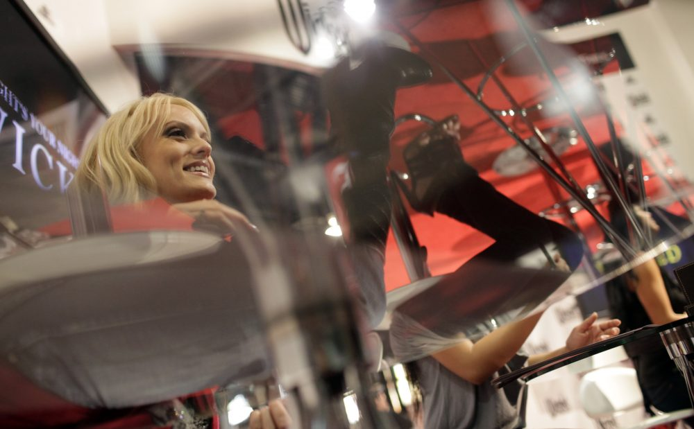 Adult film star Stormy Daniels, left, signs autographs at the AVN Adult Entertainment Expo in Las Vegas, Sunday, Jan. 11, 2009. (Jae C. Hong/AP)