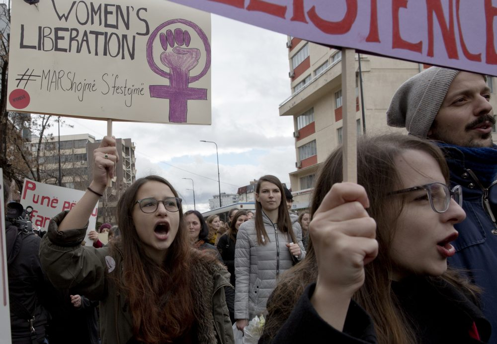 Demonstrators attend a march to commemorate International Women's Day, in the Kosovo capital Pristina, Thursday, March 8, 2018. (AP Photo/Visar Kryeziu)