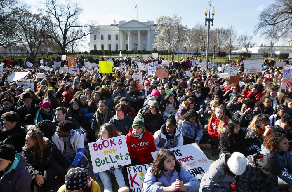 Students walked out of classes to protest gun violence on the one-month anniversary of the Parkland, Fla. school shooting. Here, students sit in silence as they rally in front of the White House in Washington. (Carolyn Kaster/AP)