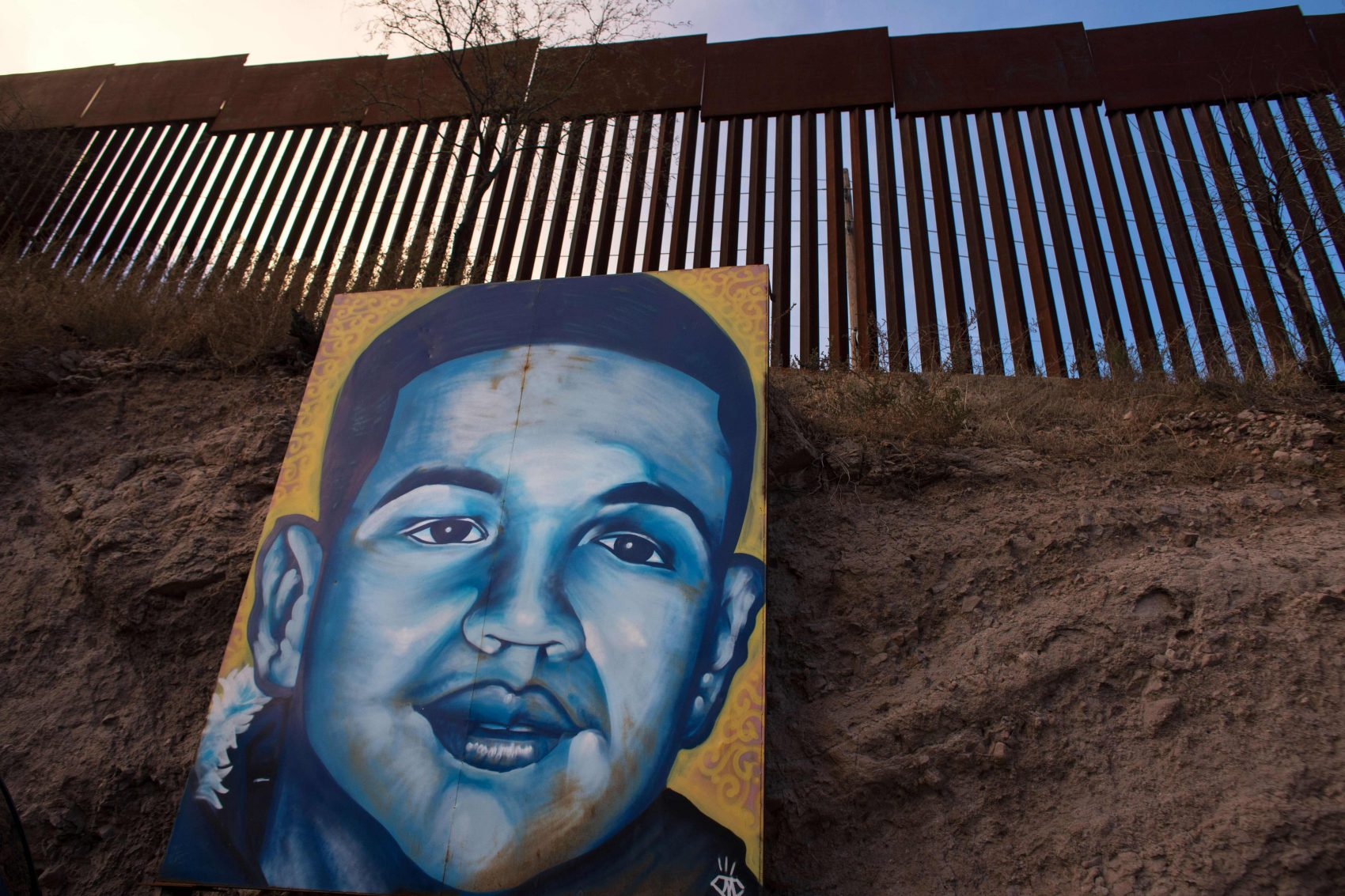 A portrait of Jose Antonio Elena Rodriguez is seen on the U.S.-Mexico border fence in Nogales, Mexico, on Feb. 16, 2017. (Guillermo Arias/AFP/Getty Images)