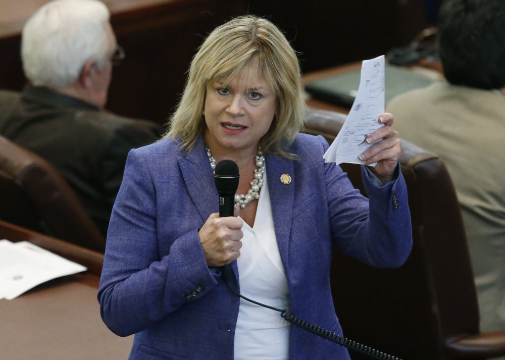 "Oklahoma state Rep. Leslie Osborn, R-Mustang, debates a budget bill on the House floor in Oklahoma City on Feb. 12, 2018. ""Without new recurring revenue, we can't fix these problems,"" said Osborn, who was ousted as chairwoman of the powerful House Appropriations and Budget committee for her outspoken support of tax increases. (Sue Ogrocki/AP)"