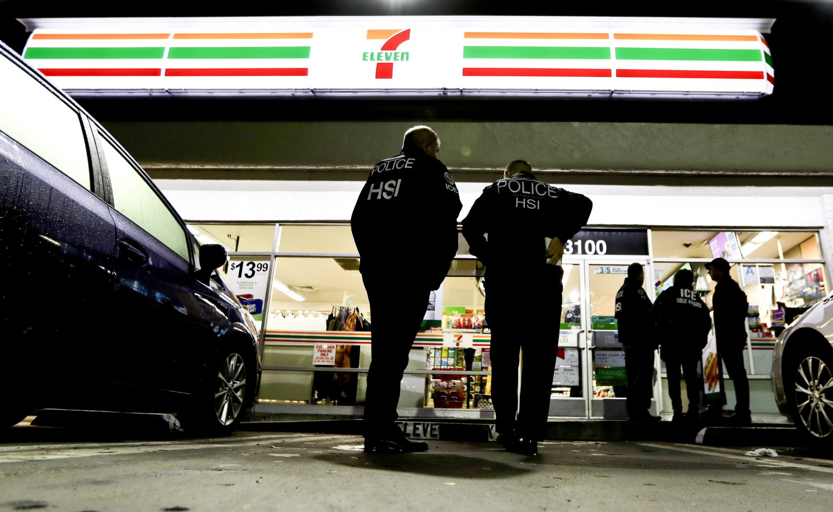 In this Wednesday, Jan. 10, 2018, file photo, U.S. Immigration and Customs Enforcement agents serve an employment audit notice at a 7-Eleven convenience store in Los Angeles. There's been backlash to the state's effort to protect immigrants from stepped up deportations under the Trump administration. (Chris Carlson/AP)