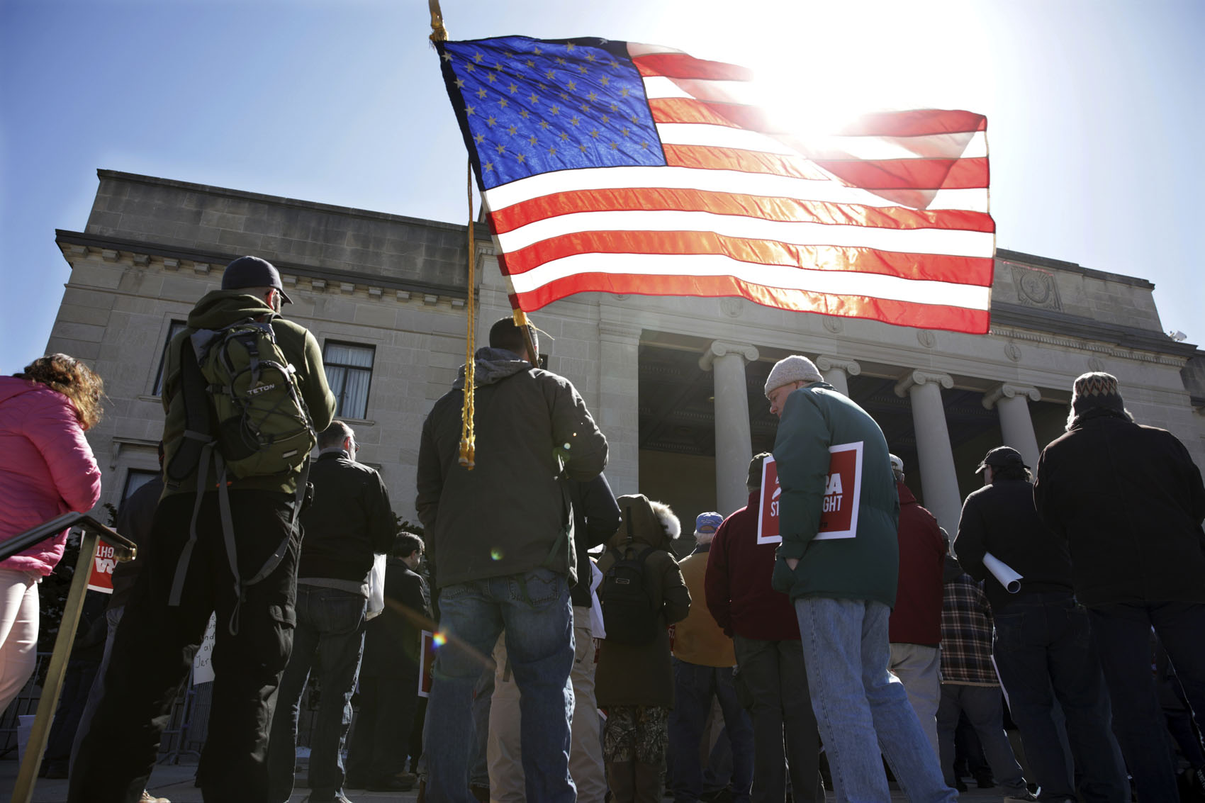 A group of Second Amendment advocates gather in opposition to about a half-dozen gun control bills on Monday, March 26, 2018, outside the War Memorial near the Statehouse in Trenton, N.J. (Mel Evans/AP)