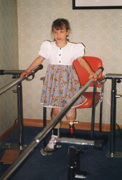Oksana's first steps, in 1998, after her first leg amputation. (Courtesy MoSwo PR)