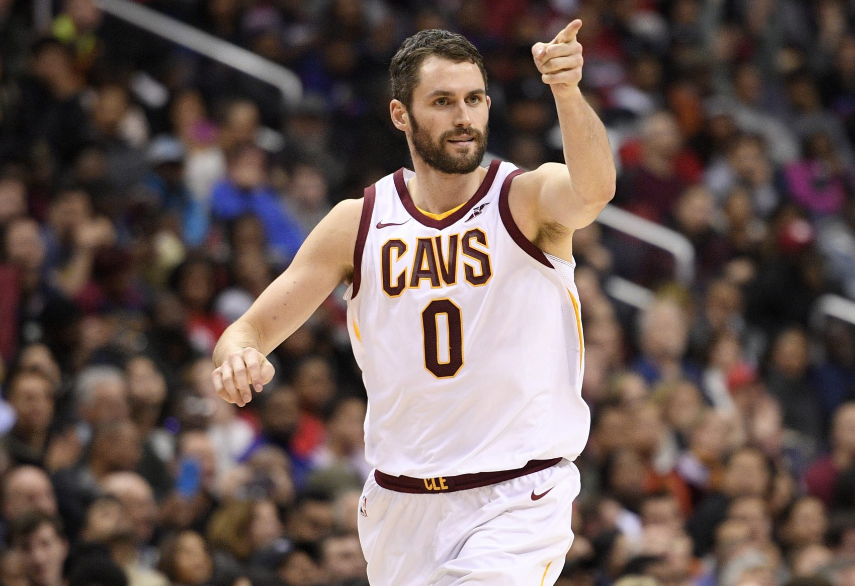 Cleveland Cavaliers forward Kevin Love (0) points after he scored during the second half of an NBA basketball game against the Washington Wizards, Sunday, Dec. 17, 2017, in Washington. The Cavaliers won 106-99. (AP Photo/Nick Wass)