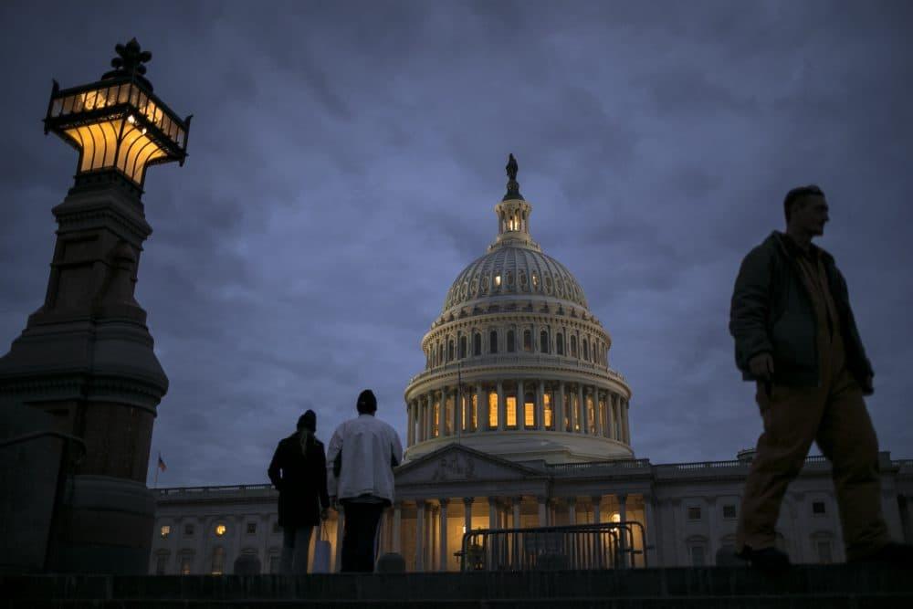 In this Jan. 21, 2018, file photo, lights illuminate the U.S. Capitol. (J. Scott Applewhite/AP)