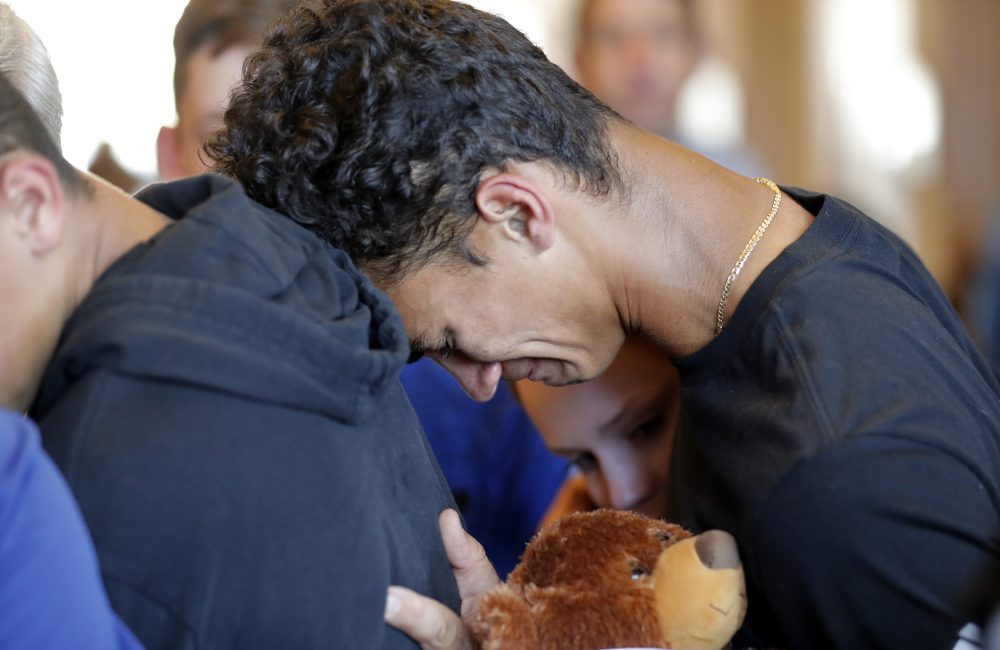 Austin Burden, 17, cries on the shoulder of a friend after a vigil at the Parkland Baptist Church, for the victims of the shooting at Marjory Stoneman Douglas High School, in Parkland, Fla. (Gerald Herbert/AP)