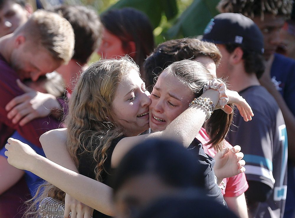 Students grieve at Pine Trails Park for the victims of the Wednesday shooting at Marjory Stoneman Douglas High School, in Parkland, Fla., Thursday, Feb. 15, 2018. (Brynn Anderson/AP)