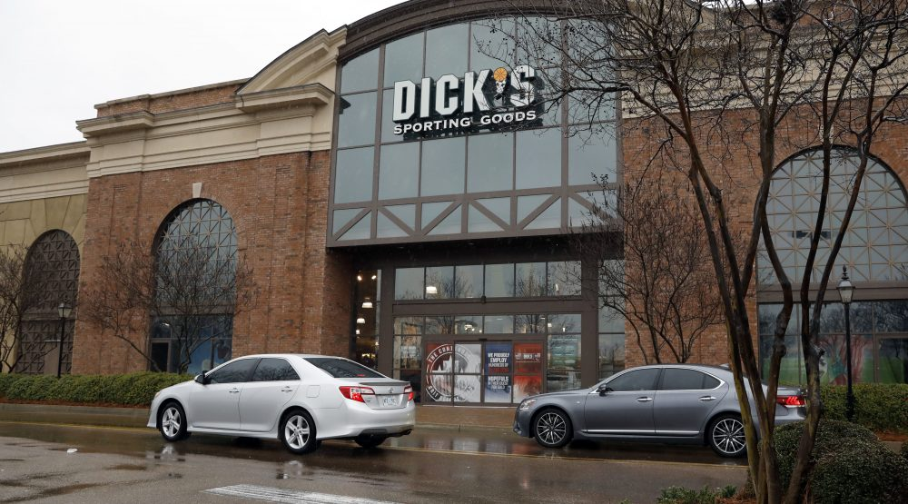 A sign for Dick's Sporting Goods store is displayed at the store Thursday, March 1, 2018, in Madison, Miss. Dick's Sporting Goods and Walmart took steps Wednesday to restrict gun sales, adding two retail heavyweights to the growing rift between corporate America and the gun lobby. (Rogelio V. Solis/AP)