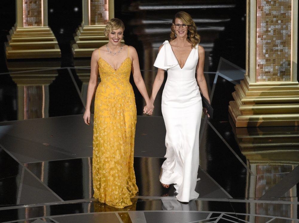 Greta Gerwig, left, and Laura Dern walk on stage to present the award for best documentary feature at the Oscars on Sunday, March 4, 2018, at the Dolby Theatre in Los Angeles. (Chris Pizzello/Invision/AP)