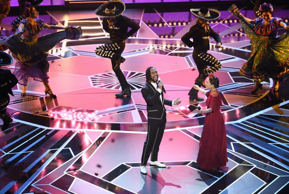 "Miguel, left, and Natalia Lafourcade perform ""Remember Me"" from ""Coco"" at the Oscars on Sunday, March 4, 2018, at the Dolby Theatre in Los Angeles. (Chris Pizzello/Invision/AP)"