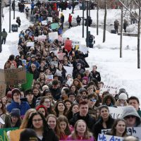 For all we are doing to try to keep students safe in school, writes Boston teacher Neema Avashia, what are we doing to keep students safe when they return to their communities? In this photo, Boston area students march to the State House in Boston on March 14, 2018. (Michael Dwyer/AP)