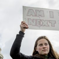 A woman holds a sign during a student led gun control rally outside the Capitol Building in Washington, Wednesday, March 14, 2018. Students walked out of school to protest gun violence in the biggest demonstration yet of the student activism that has emerged in response to last month's massacre of 17 people at Florida's Marjory Stoneman Douglas High School. (Andrew Harnik/AP)