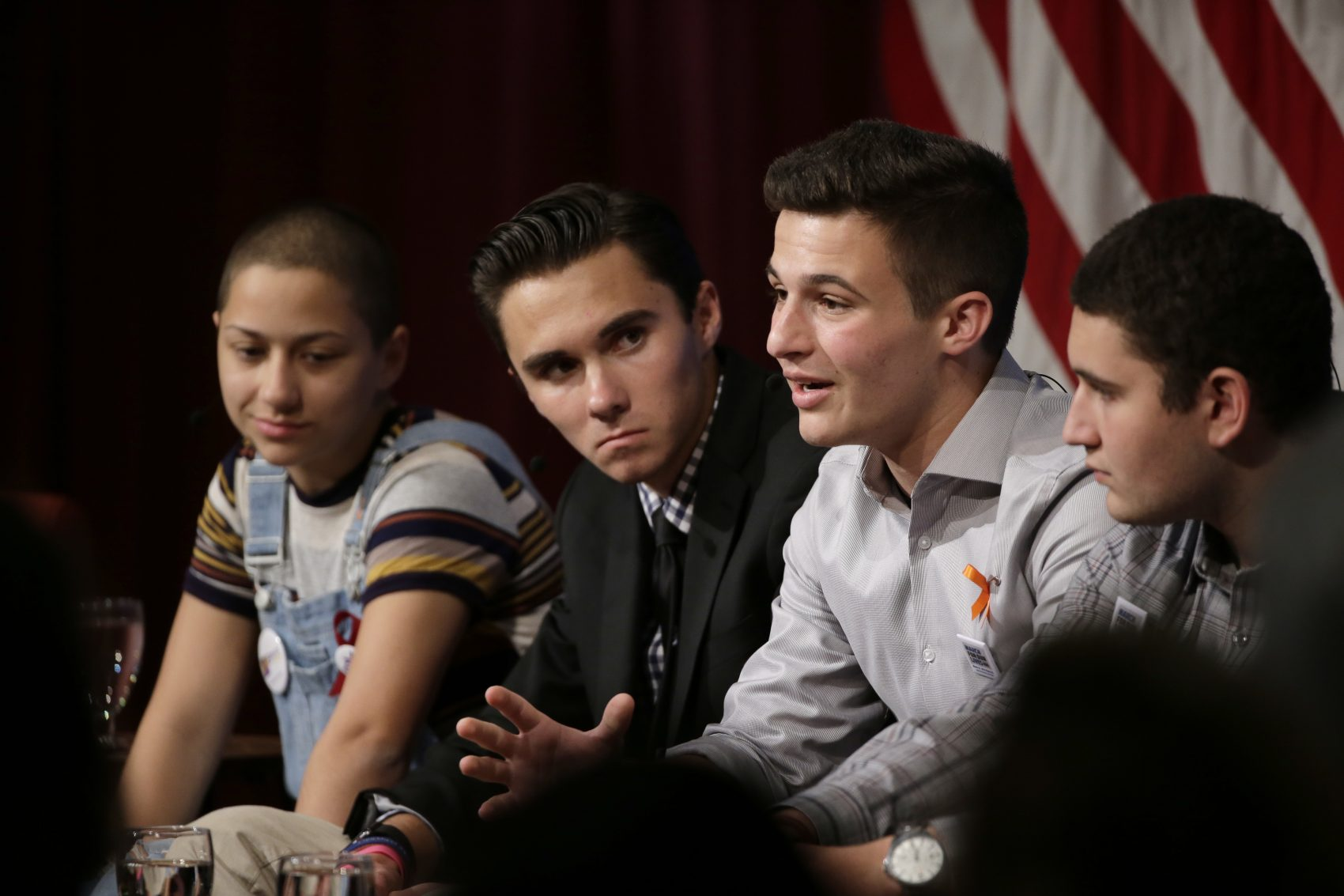 Marjory Stoneman Douglas High School students and mass shooting survivors, from the left, Emma Gonzalez, David Hogg, Cameron Kasky and Alex Wind participate in a panel discussion about guns, Tuesday at Harvard Kennedy School's Institute of Politics. (Steven Senne/AP)