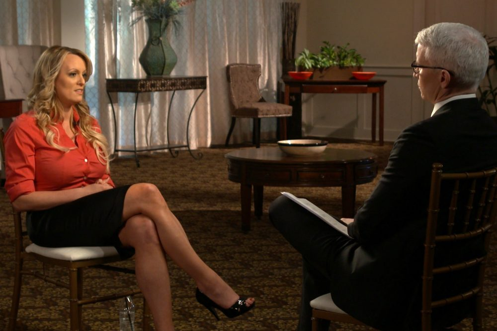 "This image released by CBS News shows Stormy Daniels, left, during an interview with Anderson Cooper which will air on Sunday, March 25, 2018, on ""60 Minutes."" (CBS News/60 Minutes via AP)"