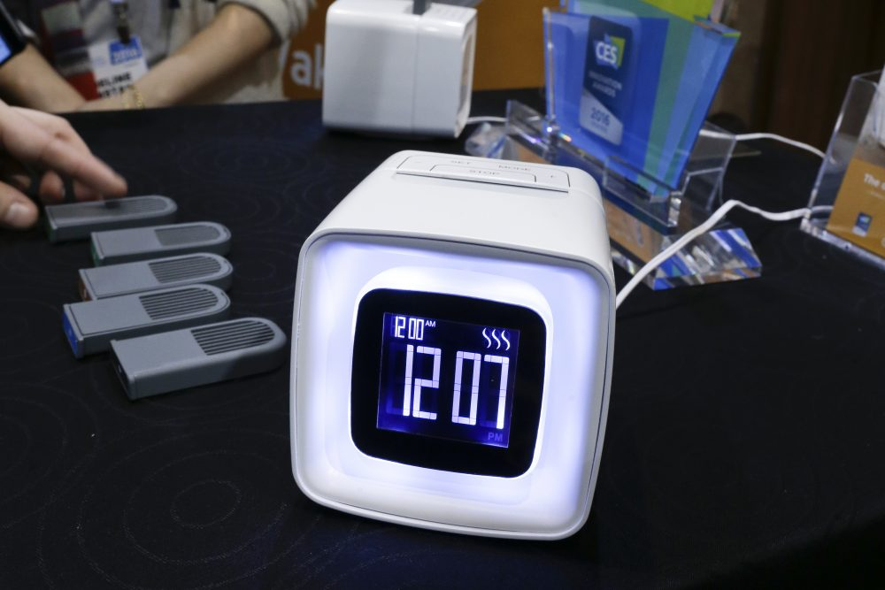 In this Monday, Jan. 4, 2016, photo, Sensorwake olfactory alarm is displayed at CES Unveiled, a media preview event for CES International in Las Vegas. The device by the French company emits scents that should get you up gently in about two minutes. The clock, selling for a promotional $89 during CES, diffuses particles contained in packets with dry air to give you a whiff of things like espresso, hot croissants, a lush jungle, chocolate or pepper mint. (AP Photo/Gregory Bull)