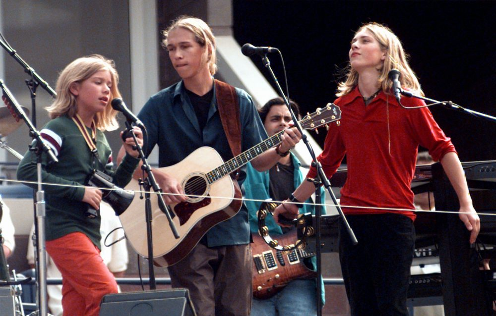 The Hanson Brothers perform in the new Arthur Ashe Stadium at the USTA National Tennis Center in New York on Aug. 23, 1997. (Adam Nadel/AP)