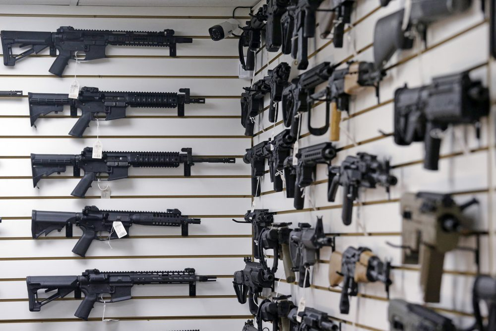 Dozens of semi-automatic rifles line a pair of walls in a gun shop Tuesday, Nov. 7, 2017, in Lynnwood, Wash. (AP Photo/Elaine Thompson)