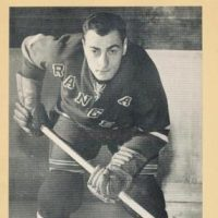 Hy Buller gave his hockey stick and puck to 10-year-old David Rubin. Though the connection was brief, the impact has not been lost. (Courtesy Elly and David Rubin)