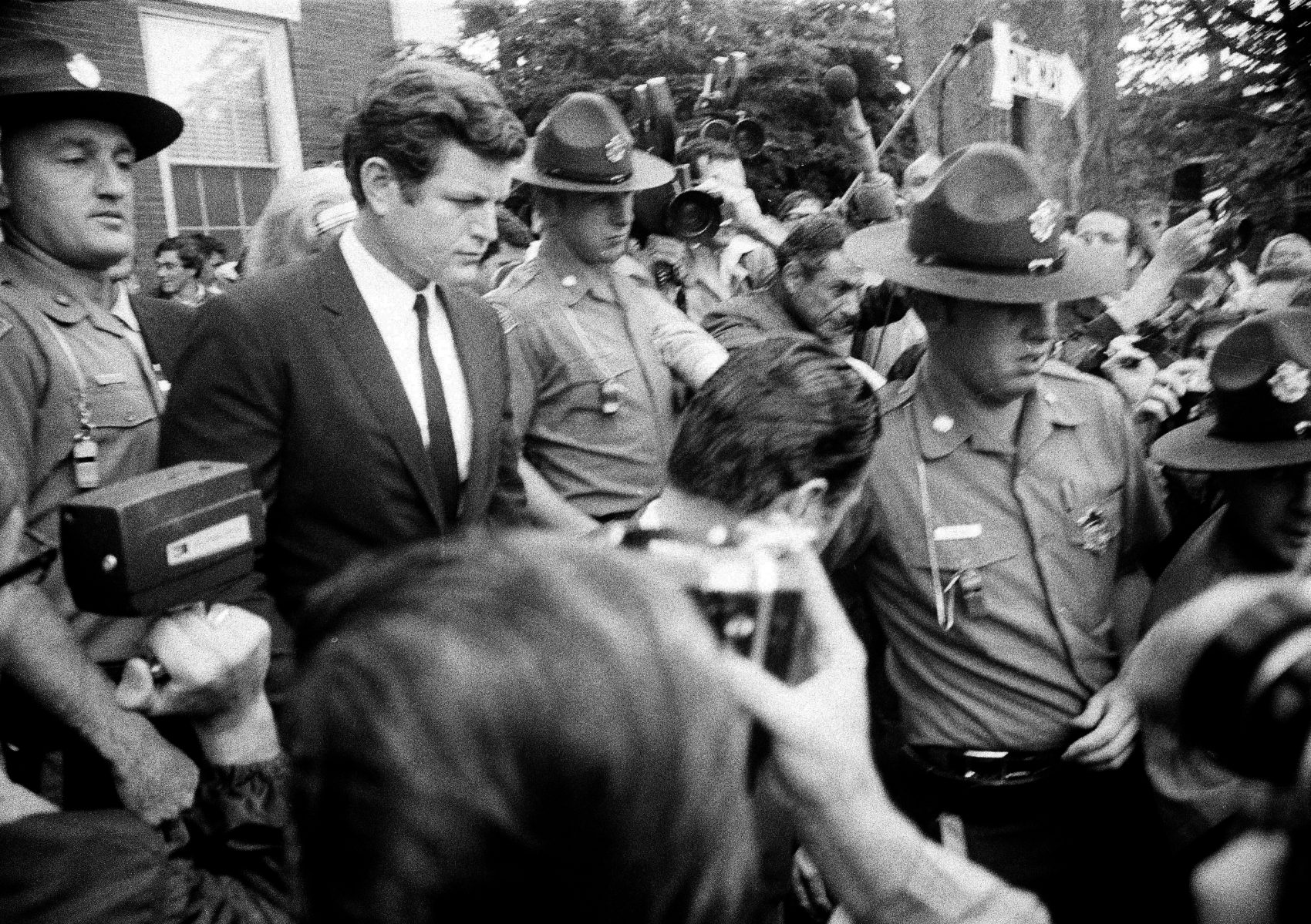 Sen. Edward M. Kennedy is escorted by troopers as he leaves court in Edgartown on, July 25, 1969, after pleading guilty to charge of leaving the scene of an accident. (Frank C. Curtin/AP)