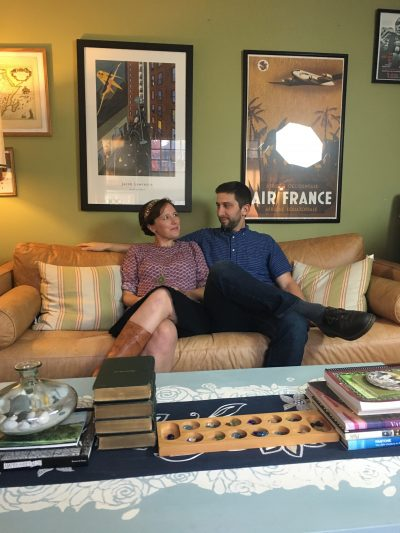 Nina Riggs and John Duberstein sit on the couch that Nina bought. (Courtesy Brettne Bloom)