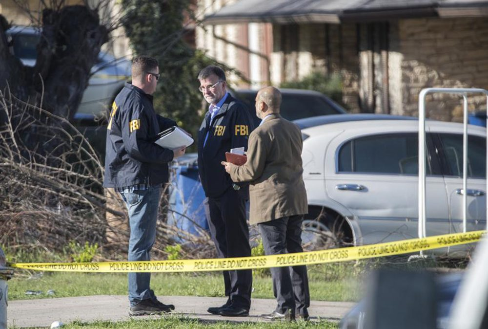 Authorities are investigating the scene in East Austin after a teenager was killed and a woman was injured in the second Austin package explosion in the past two weeks Monday, March 12, 2018. Courtesy the American-Statesman. (RICARDO B. BRAZZIELL / AMERICAN-STATESMAN)