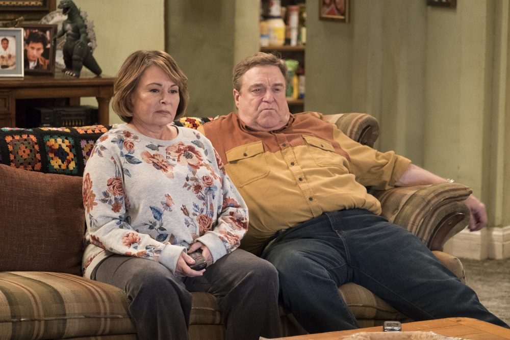 "FILE - In this image released by ABC, Roseanne Barr, left, and John Goodman appear in a scene from the reboot of ""Roseanne,"" premiering on Tuesday at 8 p.m. EST. (Adam Rose/ABC via AP, File)"