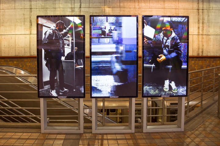 "Sydney A. Bobb's video, ""Fraternal Eclipse,"" on screen in an MBTA station. (Courtesy MBTA)"