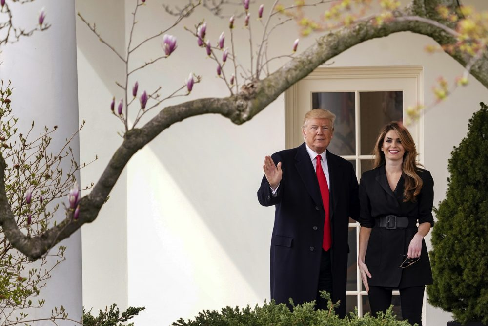 President Donald Trump waves with outgoing White House Communications Director Hope Hicks before boarding Marine One on the South Lawn of the White House in Washington, Thursday, March 29, 2018, for a short trip to Andrews Air Force Base, Md., and then on to Cleveland. (AP Photo/Andrew Harnik)