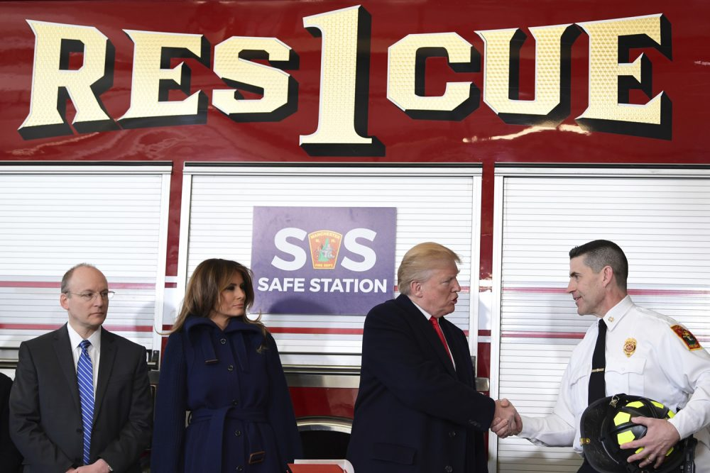 President Donald Trump shakes hands with Manchester City Fire Chief Daniel Goonan as first lady Melania Trump and Dr. William Goodman, Chief Medical Officer and Vice President of Medical Affairs for Catholic Medical Center watch during a visit to the Manchester Central Fire Station in Manchester, N.H., Monday, March 19, 2018. Trump is in New Hampshire to unveil more of his plan to combat the nation's opioid crisis. (AP Photo/Susan Walsh)