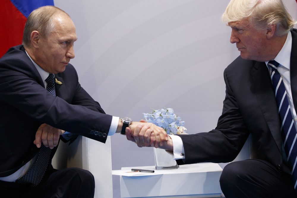 President Donald Trump shakes hands with Russian President Vladimir Putin at the G20 Summit in Hamburg. (AP Photo/Evan Vucci, File)