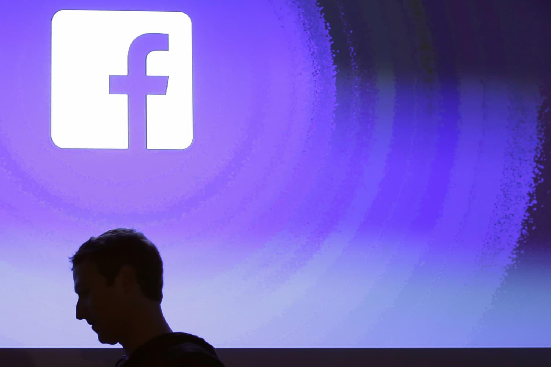 File - In this April 4, 2013 file photo, Facebook CEO Mark Zuckerberg walks at the company's headquarters in Menlo Park, Calif. (AP Photo/Marcio Jose Sanchez, File)
