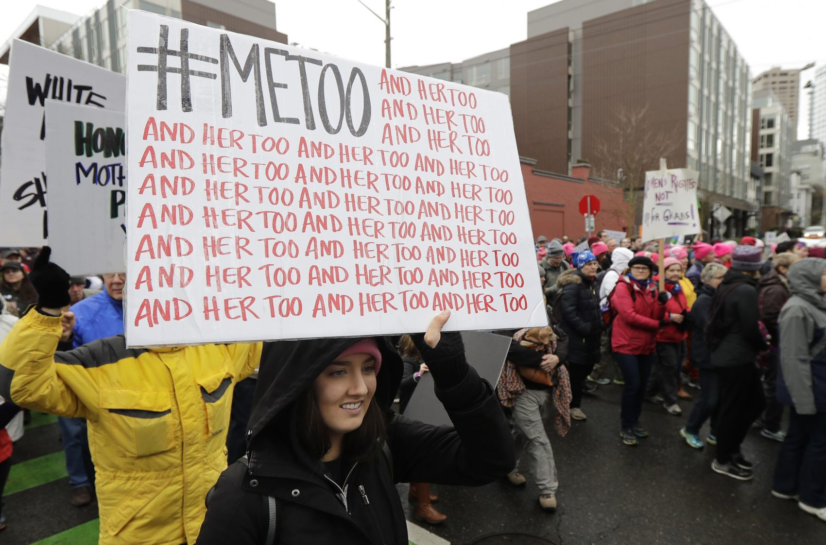 A marcher carries a sign with the popular Twitter hashtag #MeToo used by people speaking out against sexual harassment as she takes part in a Women's March in Seattle, Saturday, Jan. 20, 2018. On the anniversary of President Donald Trump's inauguration, people participating in rallies and marches in the U.S. and around the world Saturday denounced his views on immigration, abortion, LGBT rights, women's rights and more. (AP Photo/Ted S. Warren)