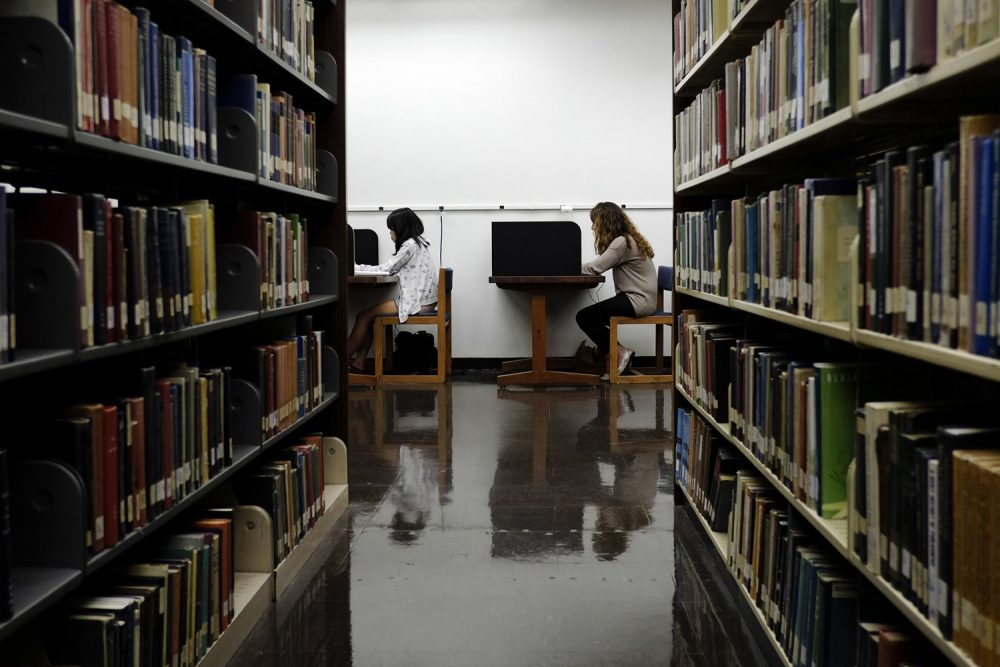 File - In this Friday, Oct. 19, 2012 file photo, students study in a library on the campus of California State University, Long Beach in Long Beach, Calif. (AP Photo/Jae C. Hong, File)