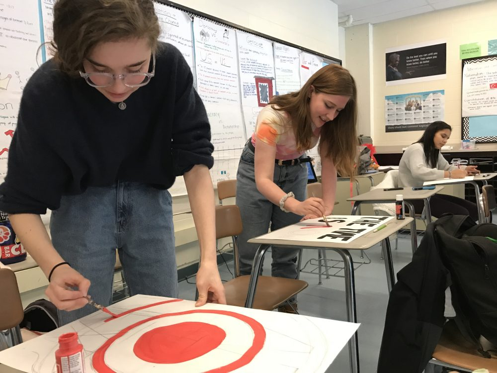 Andover High School Students make posters ahead of Wednesday's walk out. (Carrie Jung/WBUR)